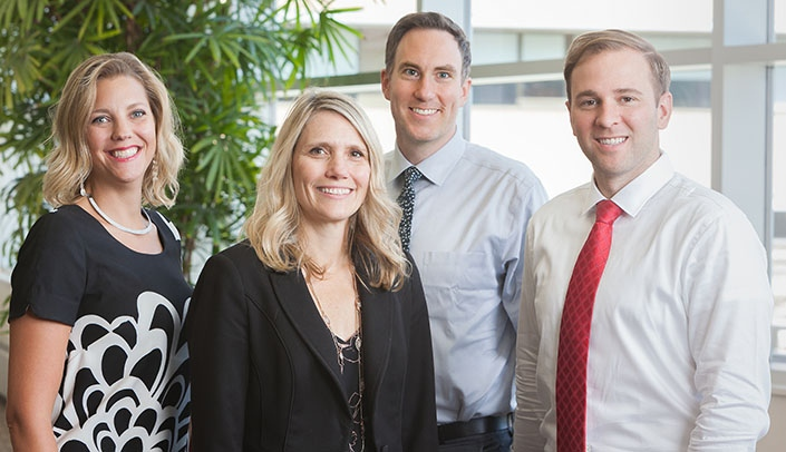 Image with caption: From left, the UNMC Division of Allergy and Immunology will include Sara May, M.D., division chief Jill Poole, M.D., Joel Van De Graaff, M.D., and Andrew Rorie, M.D.