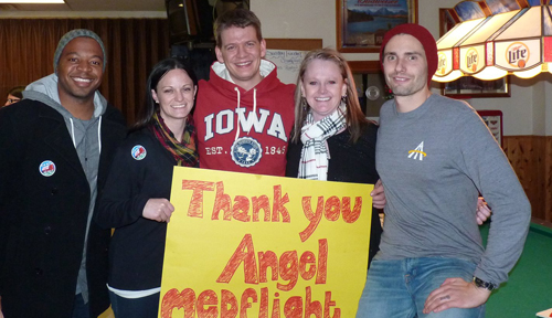 Image with caption: Michael Henkel, center, and Lori McFate, second from right, with friends during Henkel's visit.