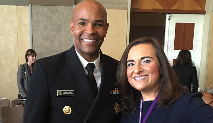 Image with caption: From left, Vice Admiral Jerome Adams, M.D., surgeon general of the United States, and Alëna Balasanova, M.D., of the UNMC Department of Psychiatry