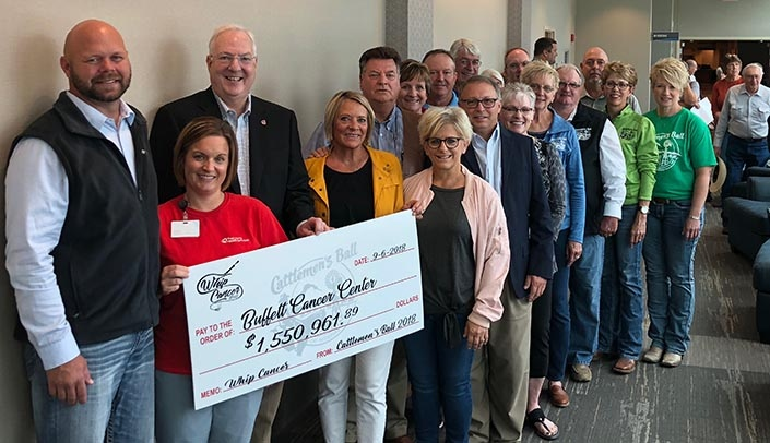 Image with caption: Ken Cowan, M.D., Ph.D. (third from left), director of the Fred & Pamela Buffett Cancer Center, went to Hebron, Neb., on Sept. 6 to receive a proceeds check of more than $1.55 million from the planning committee for this year's Cattlemen's Ball of Nebraska. (Photo courtesy of Nancy McGill)
