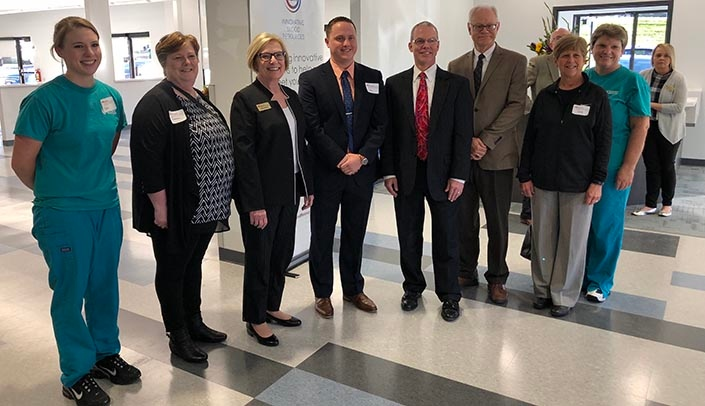 Image with caption: Nebraska Medicine leaders pose with Nebraska Community Blood Bank leadership at the opening event of the new center near 120th & Pacific streets.