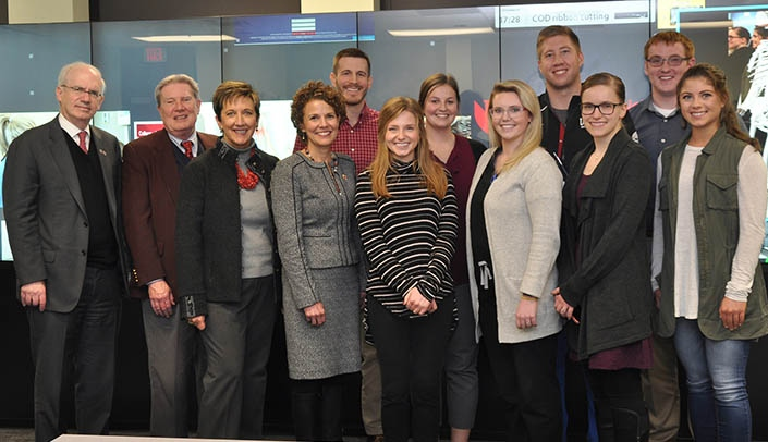 Image with caption: From left, UNMC Chancellor Jeffrey P. Gold, M.D., Vice Chancellor for External Affairs Bob Bartee, State Sen. Patty Pansing Brooks, College of Dentistry Dean Janet Guthmiller, D.D.S., Ph.D., students Paul Lewis, Kate O'Brien, Carly Johnson, Corrine Van Osdel, Michael Weber, Sara Scott, Cam Aiken and Lydia Robertus (Photos by Margaret Cain)