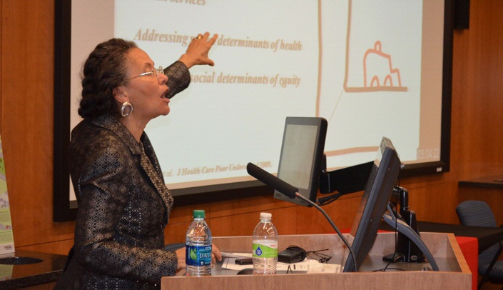 Image with caption: Camara Jones, M.D., Ph.D., speaking at the event.