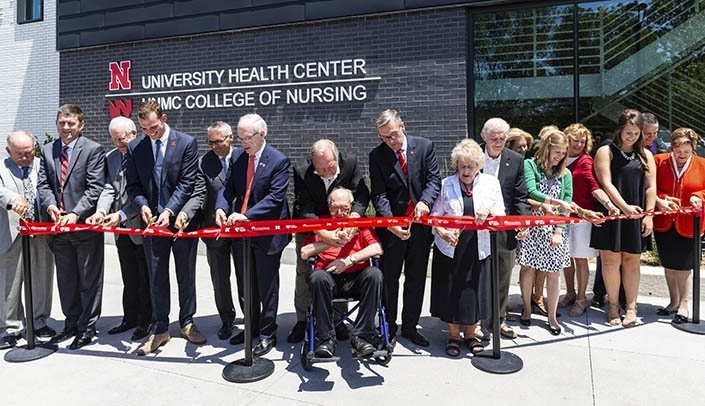 Image with caption: Supporters and University of Nebraska leaders cut the  ribbon for the new UNL Health Center/UNMC College of Nursing complex. (Photo courtesy Loren Rye, University of Nebraska-Lincoln)