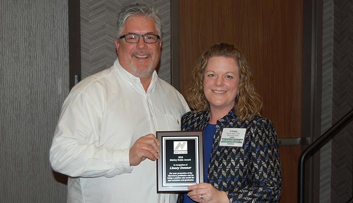 Image with caption: ASCLS-NE president-elect Brad Hays presents Linsey Donner with the Shirley Noble Award