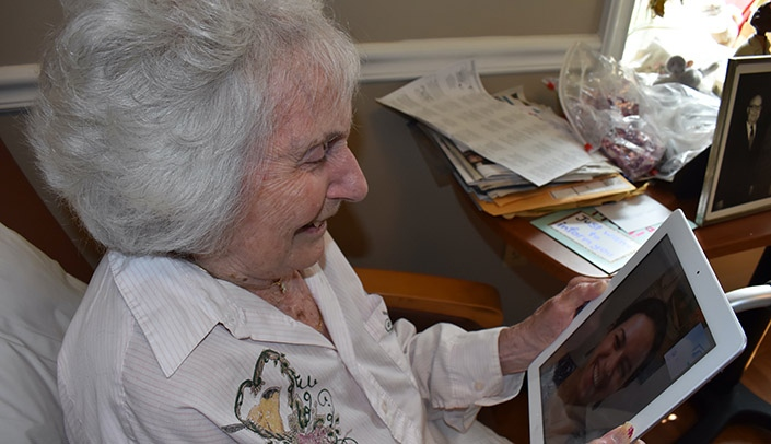 Image with caption: Estelle, a resident of the Rose Blumkin Jewish Home, gets to know pen pal Sara German, a UNMC medical student, with FaceTime.