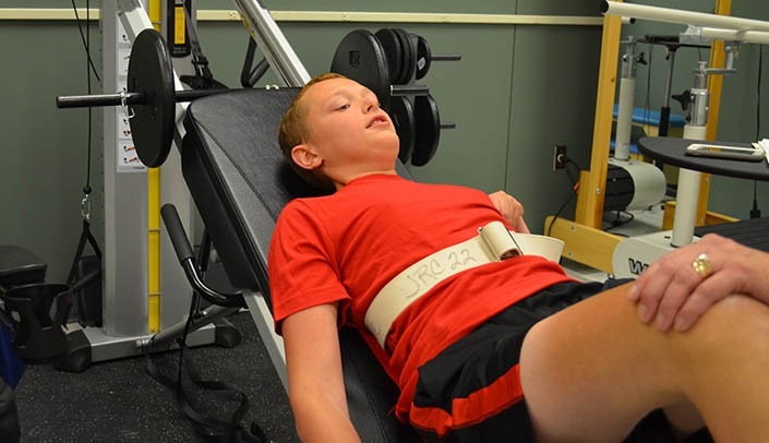 Image with caption: Ethan takes part in power-training -- the same kind of training used by athletes -- as part of his physical therapy during a new study.