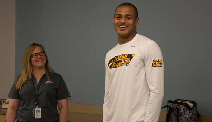 Image with caption: Noah Fant came back to Omaha to speak to the UNMC High School Alliance on Oct. 28 when the Iowa Hawkeyes had a bye week. He's seen here with Heidi Kaschke, program coordinator of the HSA. Fant, who wears No. 87, has caught eight passes for 60 yards this year, including a five-yard TD reception in a victory over Purdue. He led the team with three receptions last Saturday in a victory against Illinois. In last Sunday's sports section, an Omaha World-Herald sports reporter wrote that
