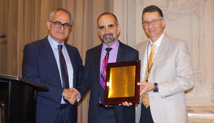 Image with caption: From left, Kamel Khalili, Ph.D., professor and chair of the department of neuroscience at the Lewis Katz School of Medicine at Temple University in Philadelphia, Dr. Gendelman, and Igor Koralnik, M.D., president of the International Society of NeuroVirology and chair of the department of neurological sciences at Rush University Medical Center in Chicago, Ill.