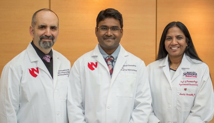 Image with caption: The three lead researchers from the UNMC Department of Pharmacology/Experimental Neurosciences include (left-right): Howard Gendelman, M.D., professor and chair, Divya Prakash Gnanadhas, Ph.D., post-doctoral research associate, and Santhi Gorantla, Ph.D., associate professor.