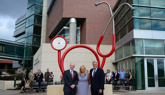 Image with caption: UNMC Chancellor Jeffrey P. Gold, M.D., at left, joined Karen and James Linder, M.D., this week at the unveiling of