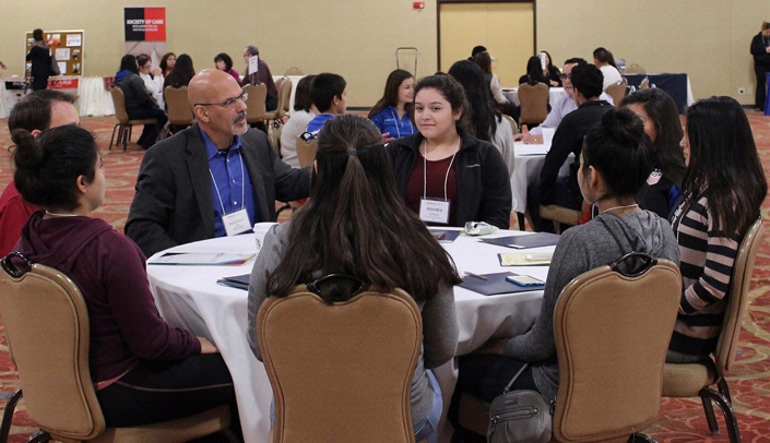 Image with caption: Brent Khan, Ed.D., BHECN co-director, leads a table top discussion on techniques to reduce test anxiety.