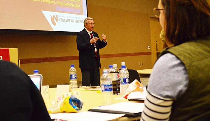 Image with caption: Charles Krobot, Pharm.D., speaks at a continuing education event for pharmacy technicians.