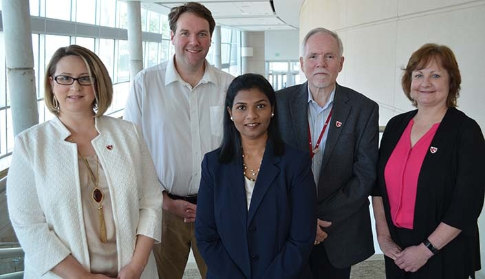 Image with caption: From left, the UNMC team includes Melissa Holzapfel, Geoffrey Talmon, M.D., Maheswari Mukherjee, Ph.D., Peter Iwen, Ph.D., and Karen Honeycutt,