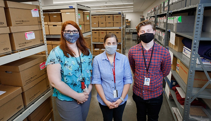 Image with caption: From left, Carrie Meyer, Erin Torell and Nick Hanson are part of the special collections and archives team.