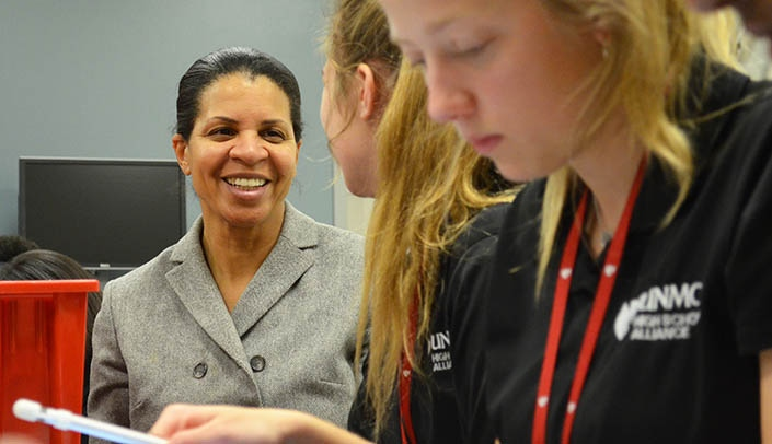Image with caption: Cheryl Logan, Ed.D., superintendent of Omaha Public Schools, chats with High School Alliance students.