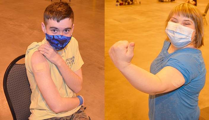 Image with caption: From left, Logan, 17, and Leah, 20, show off their vaccination band-aids Friday at Nebraska's first COVID-19 vaccination clinic for persons and families with intellectual and developmental disablities.