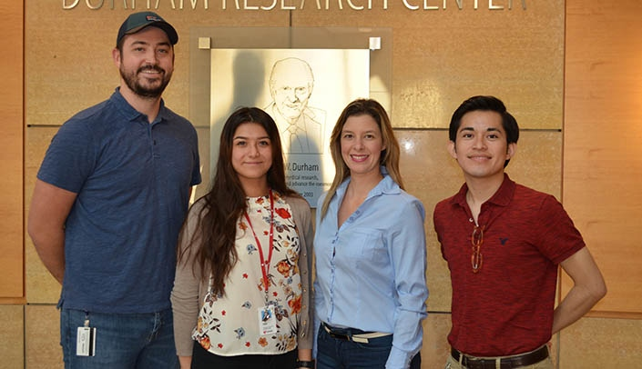 Image with caption: From left, Andrew Stothert, Ph.D., Ashley Gomez, Sharon Morais, Ph.D., and Juan Garcia.