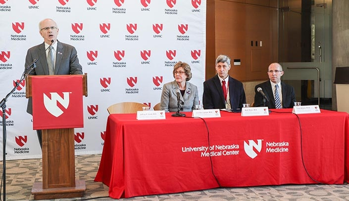 Image with caption: From left, UNMC Chancellor Jeffrey P. Gold, M.D., Jennifer Larsen, M.D., Matthew Rizzo, M.D., and Tony Wilson, Ph.D., spoke at the news conference Wednesday.