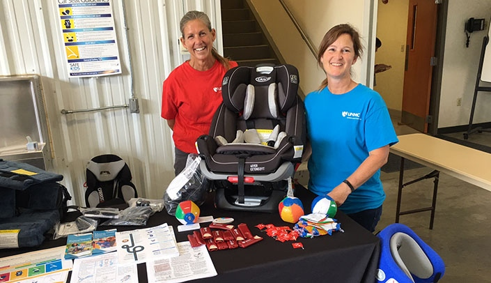 Image with caption: From left, MMI physical therapists Marne Iwand and Amy Beyersdorf at Fire and Safety Day