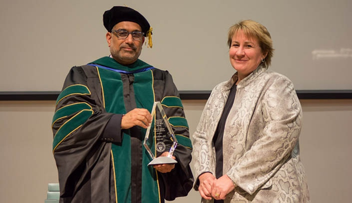 Image with caption: Ali S. Khan, M.D., M.P.H., dean of the UNMC College of Public Health, presented Judy Martin the Sparks Award in Public Health and Preventive Medicine.