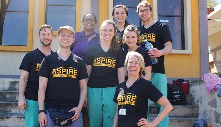 Image with caption: Back row, from left: Shirley Delair, M.D., UNMC pediatric infectious disease, Haley Mathews, Kevin Real; middle row, from left: Lee Sleightholm, student trip leader, Kaitlin Hehnke, Lauren Greufe: front row, from left: Santiago Rozo, student trip leader, and Sara Pirtle, SAGH adviser and trip organizer.