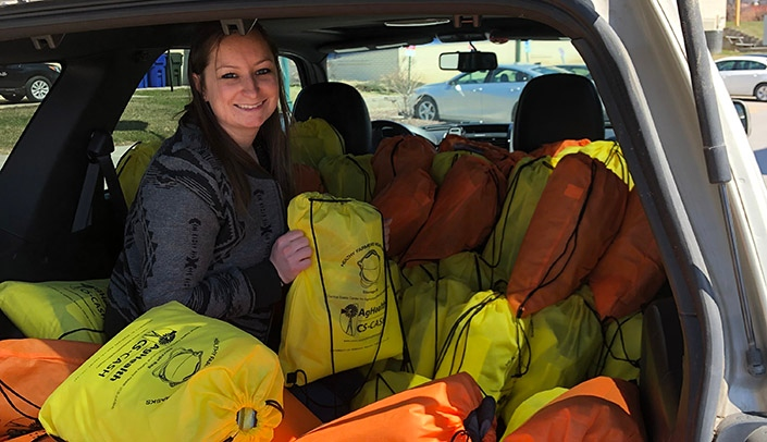 Image with caption: Jill Oatman, College of Public Health research assistant, helped deliver safe flood cleanup kits to a few communities, including her hometown of Broken Bow, Neb.