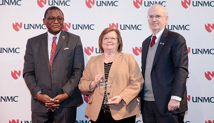 Image with caption: From left, Dele Davies, M.D., vice chancellor for academic affairs, Pamela Carmines, Ph.D., and Chancellor Jeffrey P. Gold, M.D., at the Impact in Education Awards.