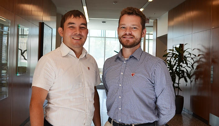Image with caption: Drs. Ildar Iskandarov, left, and Pavel Zinovyev have spent part of the summer working out details on a joint program with the College of Public Health.