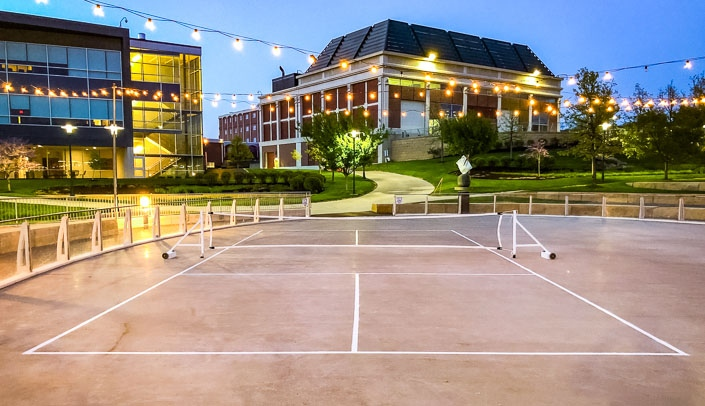 Image with caption: The ice rink at the Ruth and Bill Scott Student Plaza is currently used for intramural pickleball. University leaders are exploring other warm weather uses for the rink as part of an improvement project to the plaza.