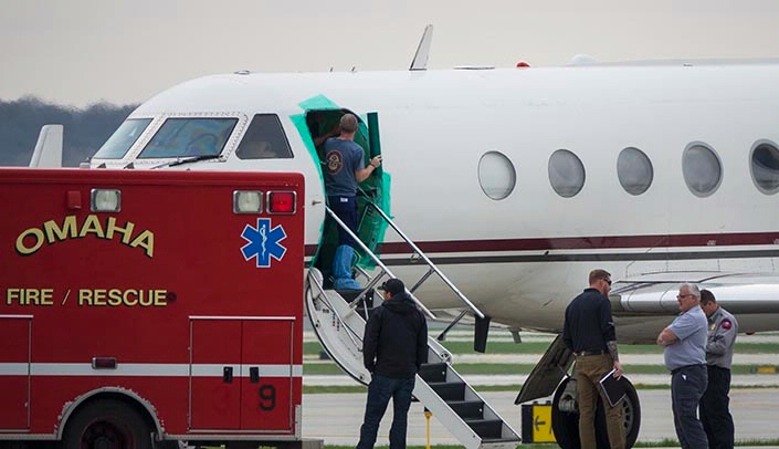 Image with caption: A plane carrying simulated patients at Eppley Airfield.