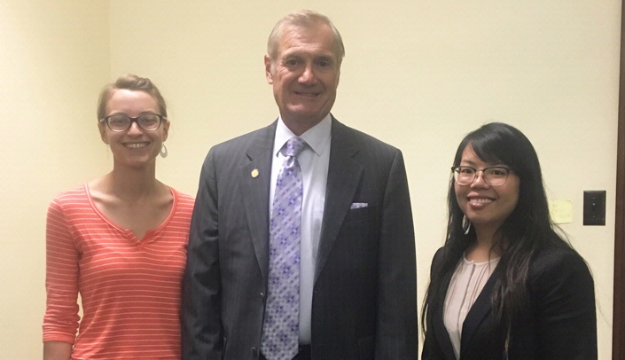 Image with caption: State Sen. Mike Gloor, who has introduced legislation to raise the tobacco tax, meets with Katie Earll (left) and Melissa Leon during their interprofessional rural rotation this fall.