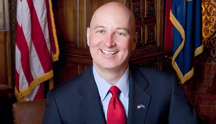 Image with caption: Gov. Pete Ricketts, who has participated in bike rides for worthy causes in the past, will join in the Break the Cycle ride with area health professionals and community leaders.