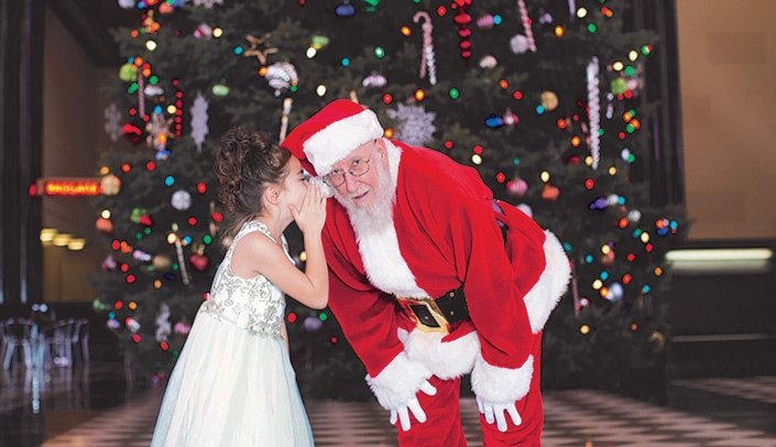 Image with caption: Santa at The Durham Museum
