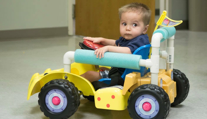 Image with caption: Santiago in his modified toy car.