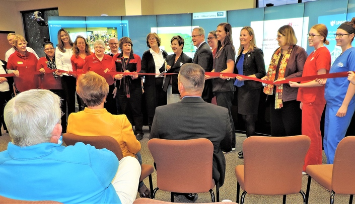 Image with caption: Simultaneous ribbon-cutting ceremonies were held in Scottsbluff and Omaha.