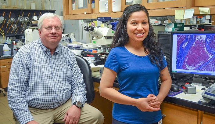 Image with caption: James Talmadge, Ph.D. (left) and Saraswoti Khadge