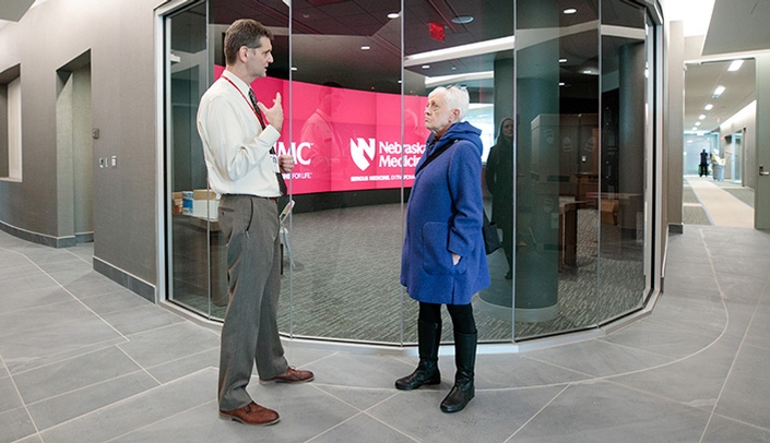 Image with caption: Ben Stobbe guides Kathy Tenopir through the Davis Global Center.