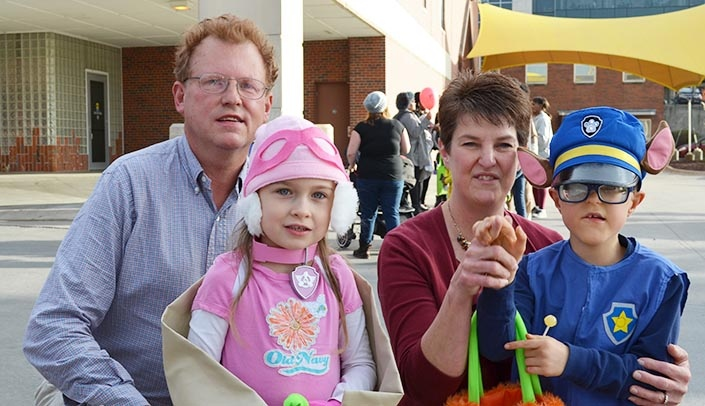 Image with caption: The Eldal family -- Brad, Mary, Lois and Alex -- came from Elk Horn, Iowa, to attend the event.