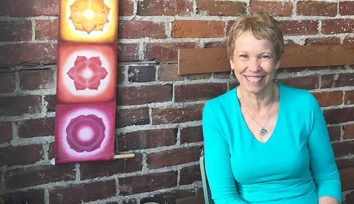 Image with caption: Deb Welk, yoga instructor and retired registered nurse, will speak on March 21 as part of UNMC's Women's History Month events.