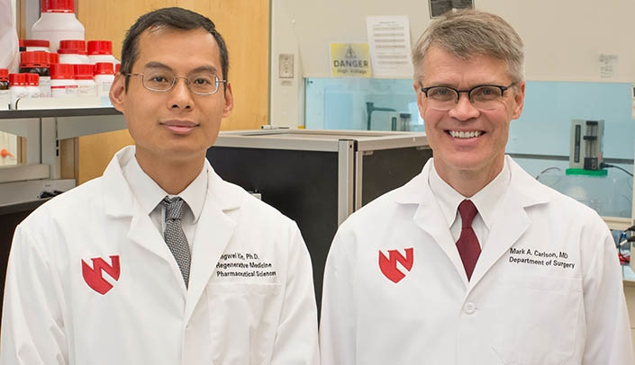 Image with caption: Jingwei Xie, Ph.D., left, and Mark Carlson, M.D., may have found a solution for a better hernia mesh.