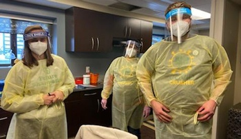 Image with caption: From left, College of Pharmacy students Sarah Stage, Kristin McLarty and Traver Pettijohn