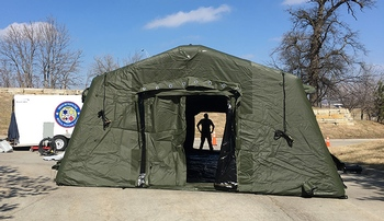Image with caption: The ED surge tent will be erected today on campus.
