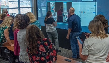 Image with caption: Students and instructors use the Interactive Digital iWall at the UNMC College of Nursing Northern Division in Norfolk.