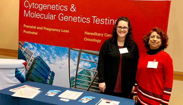 Image with caption: From left, Rachel Harris and Bhavana Dave, Ph.D., at the Great Plains IDeA-CTR annual scientific meeting.