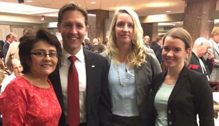 Image with caption: From left, Graciela Sharif, LEND cultural diversity coordinator, Nebraska Sen. Ben Sasse, Jennifer Brock, LEND clinical coordinator, and Malinda Childers, LEND PT resident.