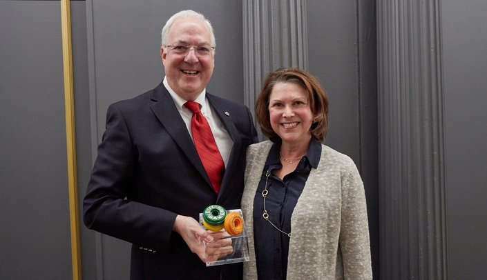 Image with caption: Ken Cowan, M.D., Ph.D., and Alison Freifeld, M.D., holding their Lifesavers Award from the Nebraska Coalition for Lifesaving Cures.