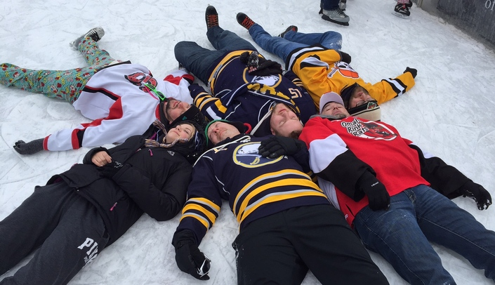 Image with caption: Six skaters skated all 24 hours at the 2017 UNMC Skate-a-thon for Parkinson's. They celebrated their accomplishment by chilling out on the ice at the end of the event.
